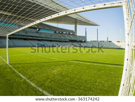 View from inside the goal in a football stadium - stock photo