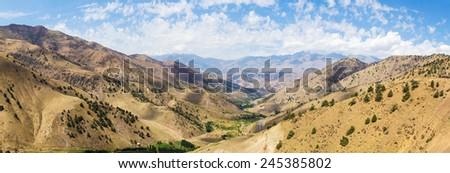 View from Kamchik (Qamchiq) mountain pass connecting Tashkent and Fergana valley, Uzbekistan. - stock photo