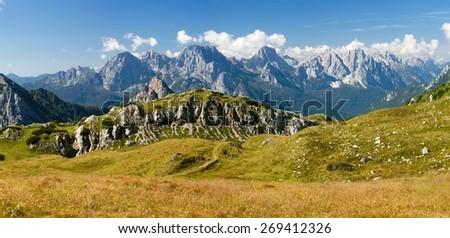View from Karnische Alpen or Alpi Carniche to Alpi Dolomiti - Mount Siera, Creta Forata and Mont Cimon - Italy - stock photo