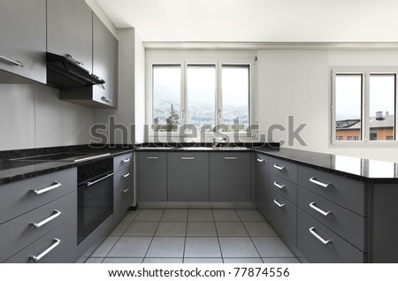 view from kitchen  of a new apartment, gray furniture