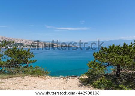 View from Krk island towards mountain Velebit / Beautiful summer seascape at Adriatic sea / Mediterranean seascape /  Summer in Baska, Krk, Croatia / Summer seascape - stock photo