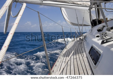 View from luxurious sailboat sailing through the ocean. - stock photo