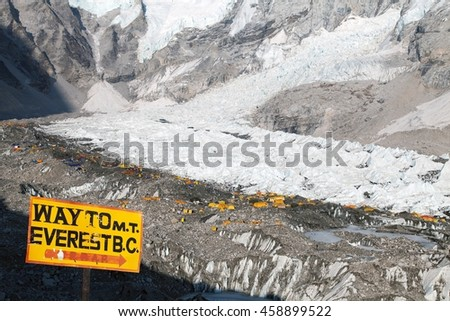 View from Mount Everest base camp, tents and prayer flags and signpost way to mount everest b.c. sagarmatha national park, trek to Everest base camp - Nepal - stock photo