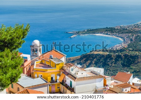 View from mountain to Taormina town and Mediterranean ocean. Sicily, Italy. - stock photo