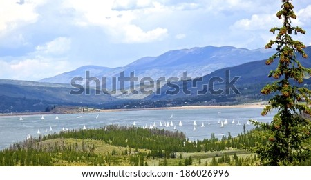 View from mountain top of sailboat race on Lake Dillon, CO/ Regatta on Lake Dillon/ same as title - stock photo