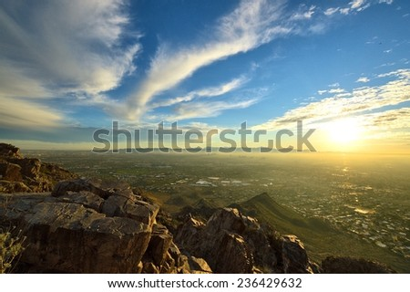 View from mountaintop of Phoenix, AZ at sunset - stock photo