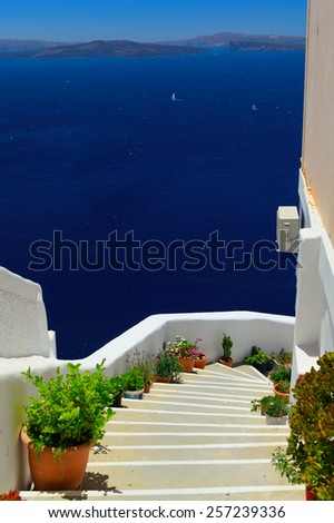 View from Oia into volcanic caldera, Santorini island, Cyclades, Greece - stock photo