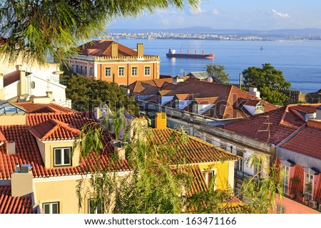 View from one of seven hills at colorful houses and Tejo river - stock photo