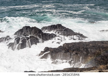 View from Pendeen lighthouse with waves crashing against the shore. cornwall England UK.