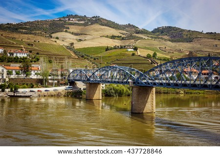 View from Pinhao village in Portugal to Douro valley and river and bridge - stock photo