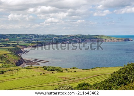 View from Ravenscar of Robin Hoods Bay in North Yorkshire, England - stock photo