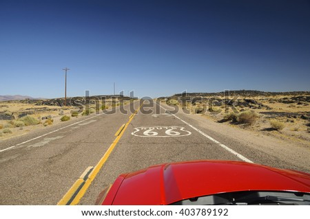 view from red car on famous Route 66 in Californian desert, USA - stock photo