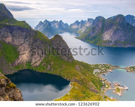 View from Reinebringen on the fishing village Reine at Moskenesoya, Lofoten with the fjord Kjerkfjord in the background. - stock photo