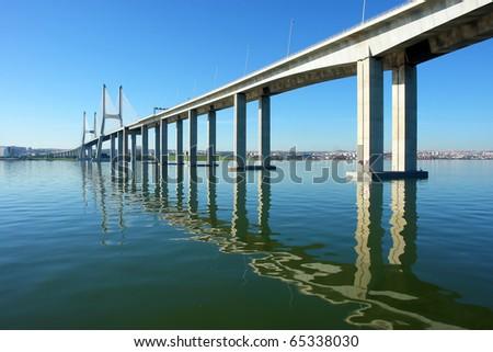 "View from river Tagus of Lisbon's ""Vasco da Gama"" Bridge, Portugal - stock photo"