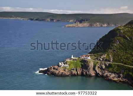 View from Signal Hill, St. John's, Newfoundland of the National Historic Site of Fort Amherst and the lighthouse on the point. The remains of gun emplacements built during WW2 are still visible. - stock photo