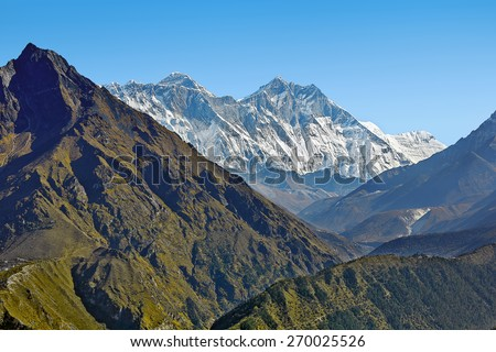 View from slope above Namche Bazar to Mount Everest, Nuptse, and Lhotse - Nepal, Himalayas - stock photo