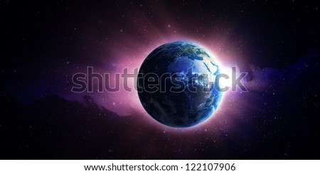 View from space of the Sun rising over Earth - stock photo