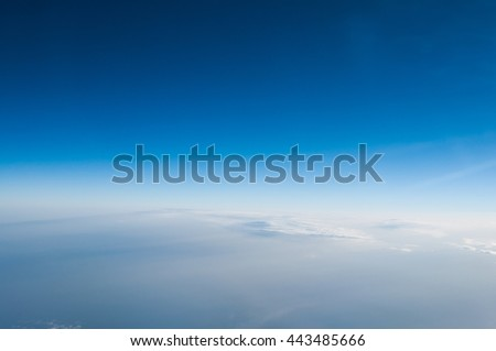 View from the airplane on the sky and clouds. White clouds against blue sky with copy space for background design