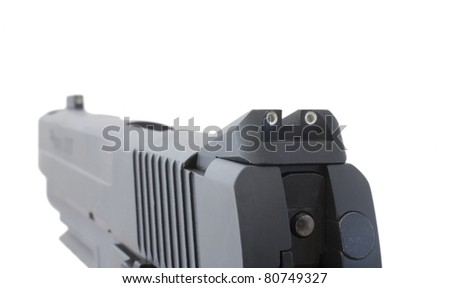 View from the back of a handgun as its being aimed - stock photo