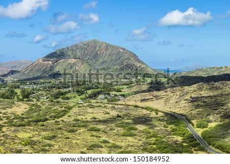 View from the back of Koko Head Crater with Diamond Head in the distance - stock photo