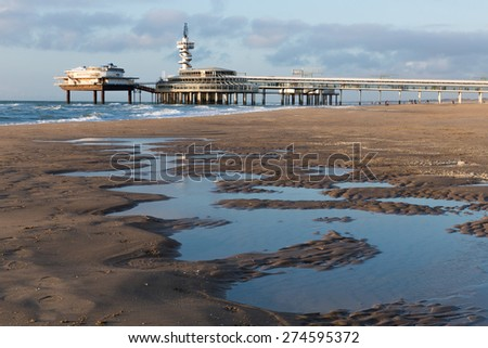 View from the beach at the famous Pier of Scheveningen, The Netherlands - stock photo