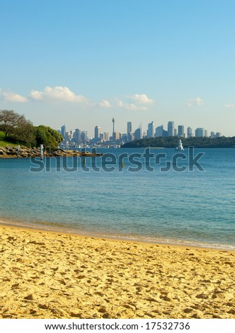 View from the beach with the Sydney skyline in the background - stock photo