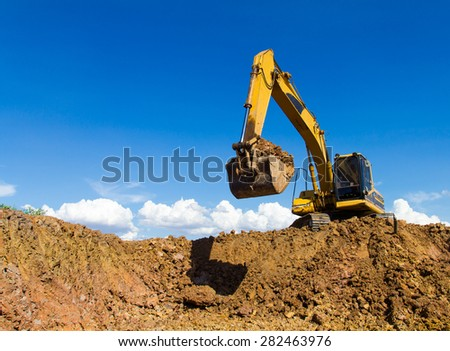 View from the bottom of the backhoe was digging a pit in the ground for rainwater. - stock photo