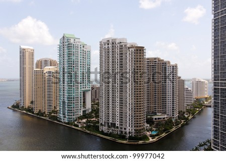 View from the Brickell neighborhood of Miami towards Brickell Key, a small island between Miami and Key Biscayne, covered in apartment towers. - stock photo