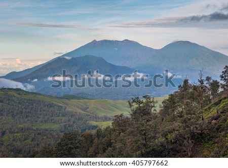 View from the caldera Kawah Ijen volcano near Bondowoso to the nearest old volcanic cone - Baluran National Park, Jawa island, Indonesia  - stock photo