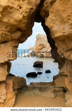 View from the cave to the sea. - stock photo