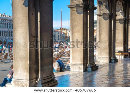 View from the columns of Doge Palace at people, tourists on San Marco square, Vennice, Italy - stock photo