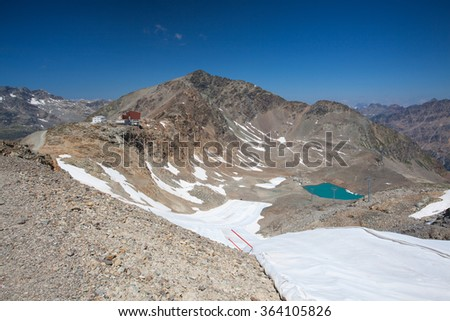 View from the Diavolezza to the mountains.The remnants of glacier covered with special plastic foil. Switzerland - stock photo