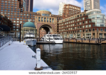 view from the dock at boston harbor and rowes wharf and skyscraper buildings in boston massachusetts - stock photo
