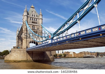 view from the excursion boat on the central span of the Tower Bridge over the Thames, London, England - stock photo