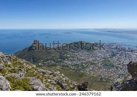 View from the flat top of Cape Town's Table Mountain. Views of Cape Town city, Atlantic ocean, harbor and Lion's Head hiking peak can be seen from the various cliff orientated mountain outlooks. - stock photo