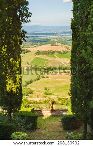 View from the garden on Tuscan fields, Italy - stock photo