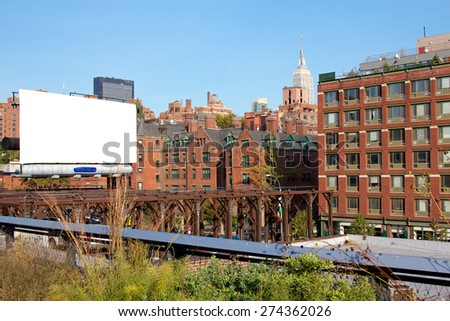 View from the Highline past an empty billboard in New York, NY, USA. - stock photo