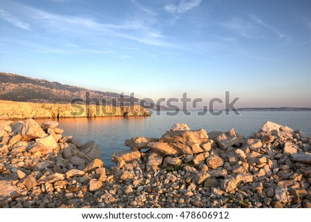 View from the island Rab towards Velebit mountain, Croatia at sunset / Seascape at Adriatic sea in Croatia at sunset