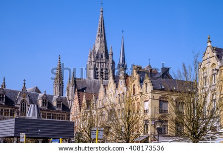 View from the main square of the Flemish architecture of Ypres (Ieper), Belgium, with the spire of St. Martin's Cathedral in the background