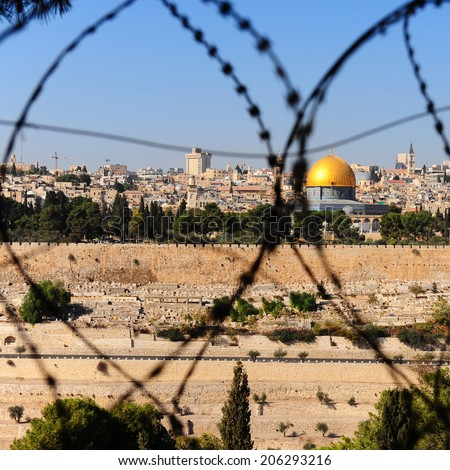 View From the Mount of Olives on the Dome of the Rock Through the Barbed Wire in Jerusalem, Israel - stock photo