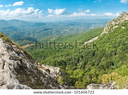 view from the mountain on green valley in sunny summer day, Krasnodar region, Russia - stock photo