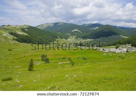 view from the mountains to the valley - stock photo