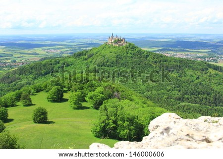 View from the peak of Zeller Horn to Hohenzollern Castle in the Swabian Alb, Baden-Wuerttemberg, Germany - stock photo