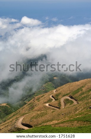 view from the plateau, Paul de Serras, Madeira showing the twisty road down the side of the plateau - stock photo
