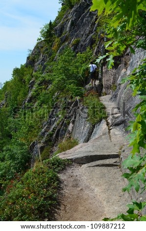 View from the precipice trail in Acadia National Park looking at Bar Harbor along the cliff ledge - stock photo