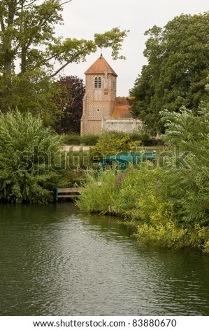 View from the River Thames of the church of St Margaret at Mapledurham near Reading, Berkshire.