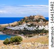 View from the road down to the popular town of Lindos on the Island of Rhodes Greece Europe - stock