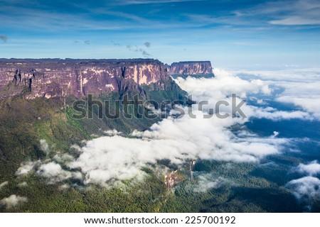 View from the Roraima tepui on Kukenan tepui at the fog - Venezuela, Latin America  - stock photo