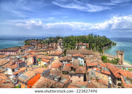 View from the Scaliger castle to the romantic little city Sirmione at the Lake Garda in Italy  - stock photo