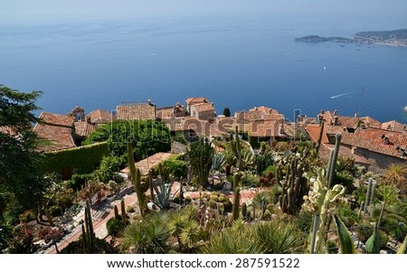 View from the top of the Eze garden on the village. Eze, renowned tourist site on the French Riviera, is famous worldwide for the view of the sea from its hill top and its beautiful women' statues. - stock photo